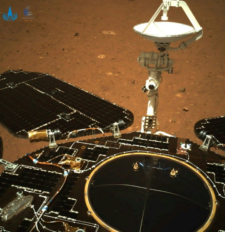 AFP  This picture released on May 19, 2021, by the China National Space Administration (CNSA) via CNS shows an image taken by the navigation camera of China's Zhurong rover on the surface of Mars, showing the rover's solar panels and antenna, after it landed on Mars on May 15, 2021.